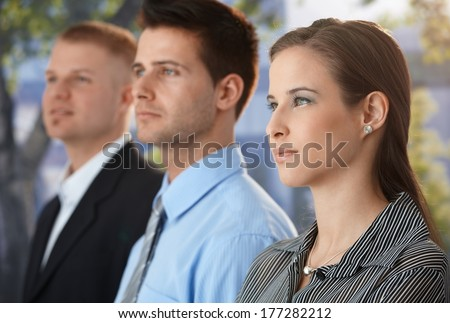 Portrait of determined business group standing outside of office. - stock photo