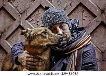 Portrait of dirty tramp with closed eyes and his dog. Image with toning and selective focus - stock photo