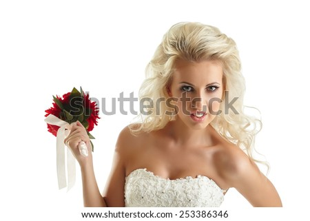 Portrait of disaffected bride with bouquet - stock photo