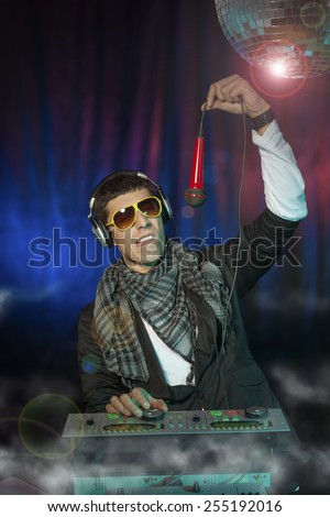 Portrait of DJ - MC. Disc Jockey  in a trance. - stock photo