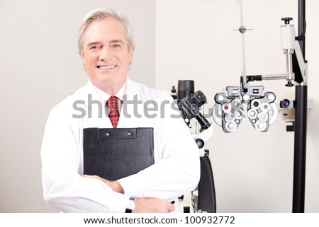 Portrait of doctor in ophthalmology clinic. - stock photo