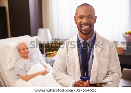 Portrait Of Doctor With Senior Male Patient In Hospital Bed - stock photo