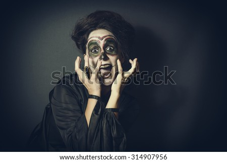 Portrait of dog in disguise for Halloween - stock photo