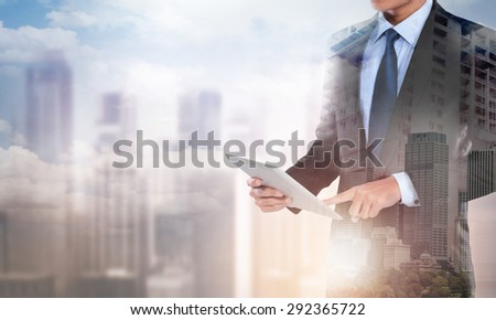 portrait of Double exposure of businessman working with new modern computer tablet show social network structure concept - stock photo