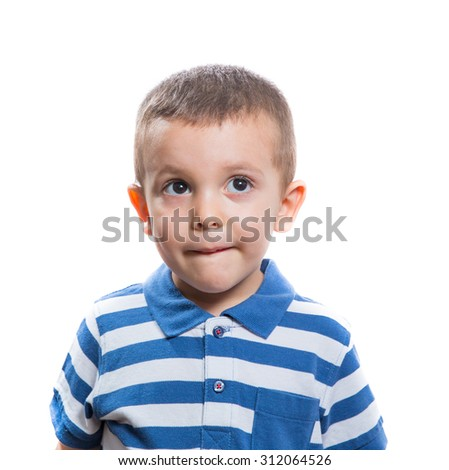Portrait of dubious beautiful little boy isolated on white background - stock photo