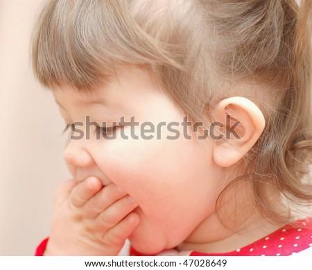 Portrait of eating baby girl - stock photo