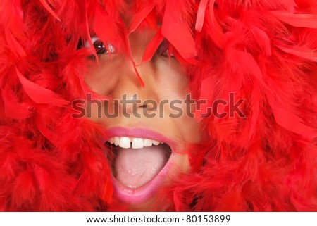 portrait of  ecstatic woman beauty in vivid red feather