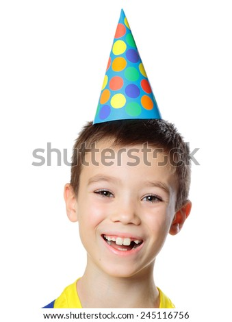 Portrait of eight years boy with birthday cap on white background - stock photo