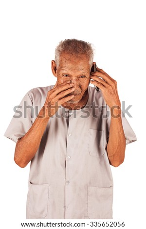 portrait of elder Eighty three year old sad and  hold smart phone  - stock photo