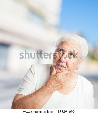 portrait of elder woman thinking about something