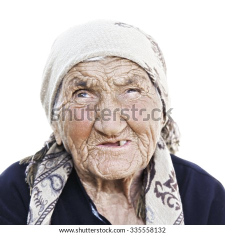 Portrait of elderly caucasian woman looking up against white