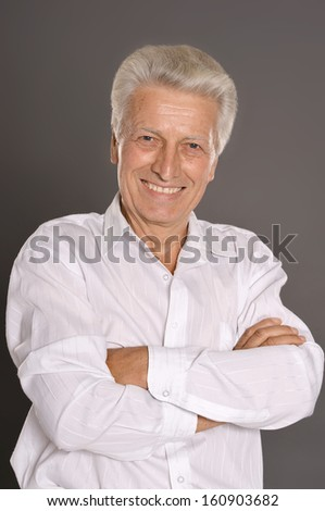 Portrait of elderly man isolated on grey background