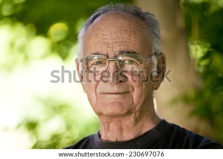 Portrait of Elderly man looking At The Camera - stock photo