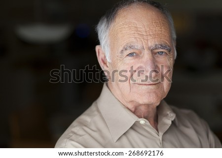 Portrait of Elderly Man Smiling At The Camera - stock photo