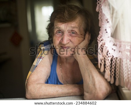 Portrait of elderly woman. - stock photo