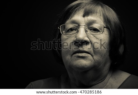 Portrait of elderly woman. Attention. Toned.
