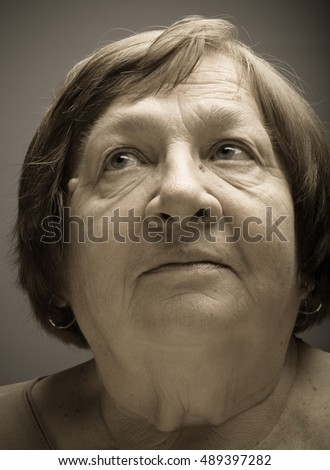 Portrait of elderly woman. Dream. Toned.