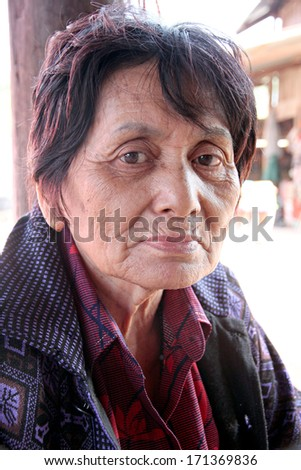 Portrait of elderly woman in the countryside,Thailand. - stock photo