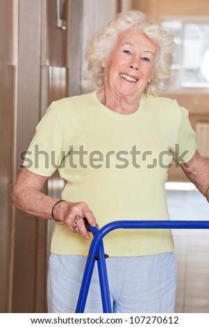 Portrait of elderly woman with zimmerframe. - stock photo