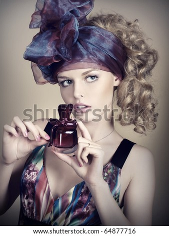 Portrait of elegant and sexy woman with perfume. Art and beauty - stock photo