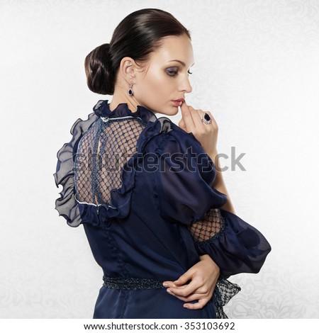 Portrait of elegant beautiful woman on light background - stock photo
