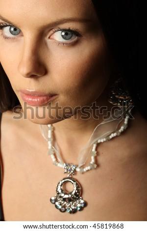 Portrait of elegant beautiful woman wearing jewelry. - stock photo
