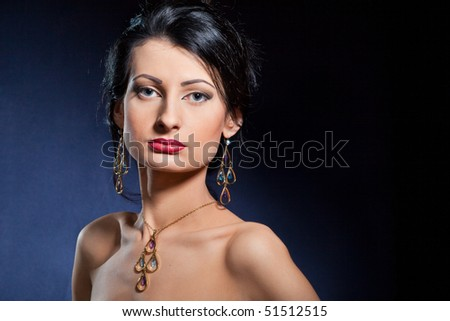 Portrait of elegant beautiful woman wearing jewelry.