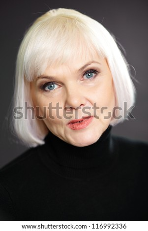 Portrait of elegant female posing in front of camera - stock photo