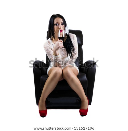 Portrait of elegant girl, dressed in white, drinking wine sitting on the couch, isolated on white - stock photo