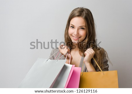 Portrait of elegant gorgeous young brunette shopper. - stock photo