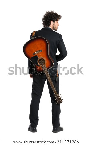 Portrait Of Elegant Man Carrying Guitar Over White Background - stock photo