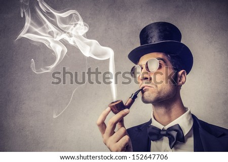 portrait of elegant man with cylinder and pipe