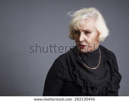 Portrait of elegant senior woman - stock photo