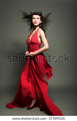 Portrait of elegant  woman in red dress - stock photo