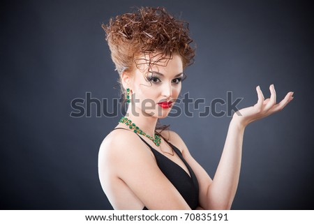 Portrait of elegant woman with juwelry, close up studio shot