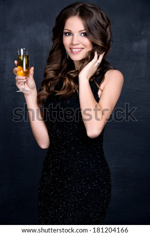 Portrait of elegant young woman with a champagne glasses at celebration - stock photo