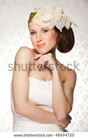 portrait of elegant young woman with flower on her head - stock photo