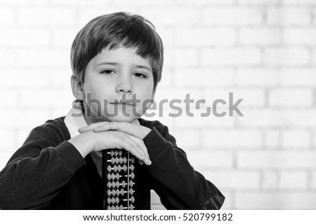Portrait of elementary school boy with  abacus.