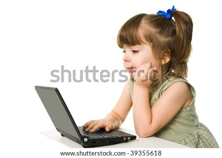 Portrait of elementary school girl looking at laptop screen with thoughtful expression - stock photo