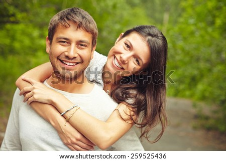 Portrait of embracing young people - stock photo
