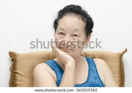 Portrait of emotion asian senior woman with toothache - stock photo