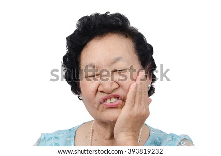 Portrait of emotion Asian senior woman with toothache on white background, with clipping path - stock photo