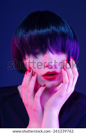 portrait of emotional brunette in studio - stock photo