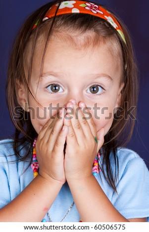 Portrait of emotionally kid. Funny little girl on blue background. Beautiful caucasian model. - stock photo