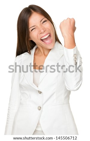Portrait of energetic young businesswoman clenching fist isolated over white background - stock photo