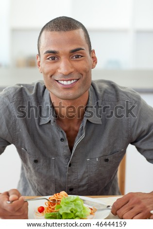Portrait of ethnic man dinning in the kitchen - stock photo