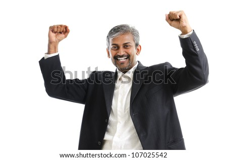 Portrait of excited Asian Indian businessman celebrating success over white background - stock photo