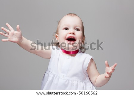 Portrait of excited cute baby with open mouth and hands