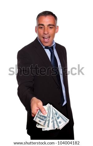 Portrait of excited executive holding and showing cash money on isolated background - stock photo