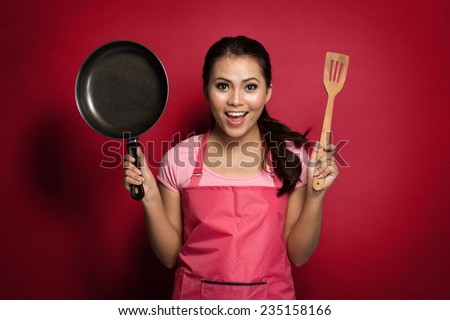 portrait of excited female chef or house wife ready to cook - stock photo